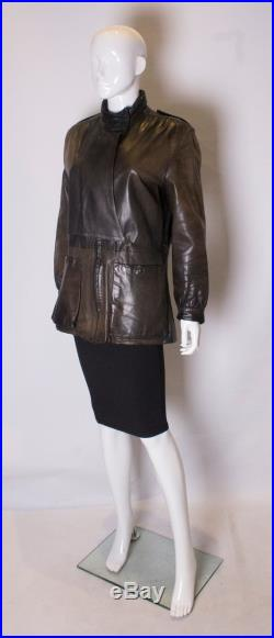 A vintage 1990s faded black leather unisex