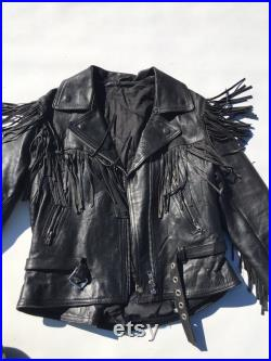 Black Fringe motorcycle jacket by Echtes leder. Pre-loved, used and worn. Lining has some shredding. Size 14. Made in Pakistan