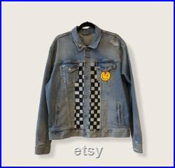 Hand painted denim jacket with a custom patch and pin.